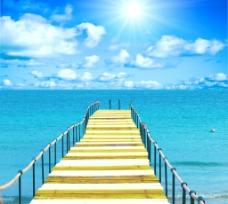 蓝天白云海洋木桥图片